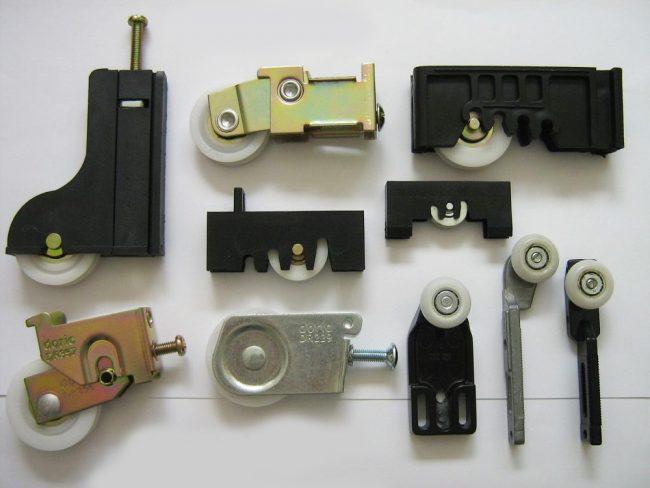 Systèmes de roulettes pour armoires coulissantes