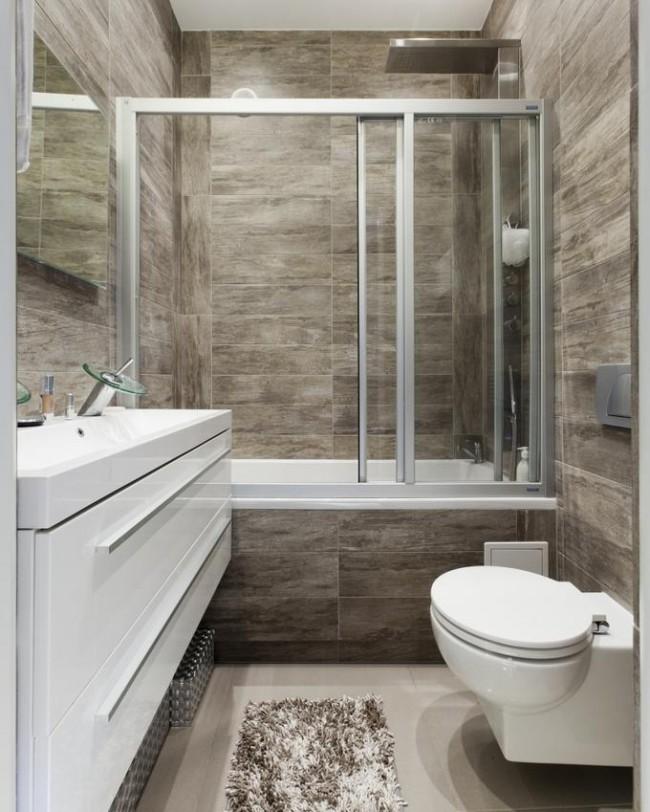 La cabine de douche peut également être remplacée par une cloison vitrée équipant la baignoire