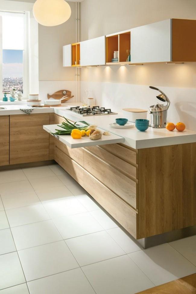 Une abondance de tiroirs et une planche coulissante qui augmente la surface de travail conviennent également dans une petite cuisine