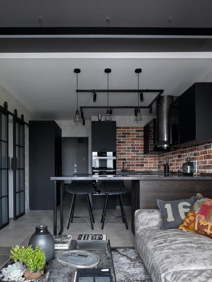 studio de style loft avec un bar