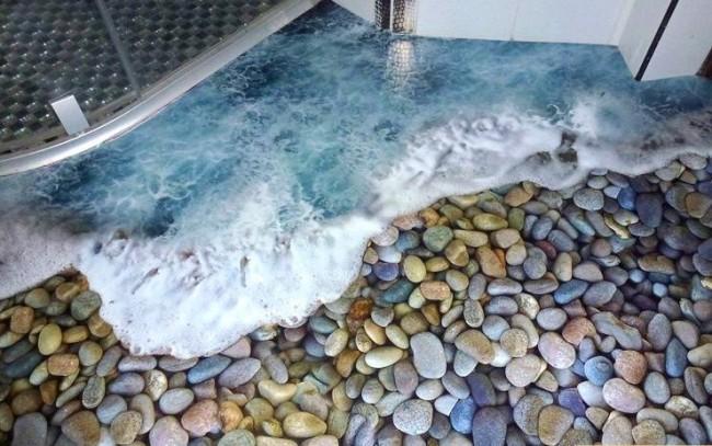 Sol autonivelant avec l'image d'une vague de mer sur des galets colorés
