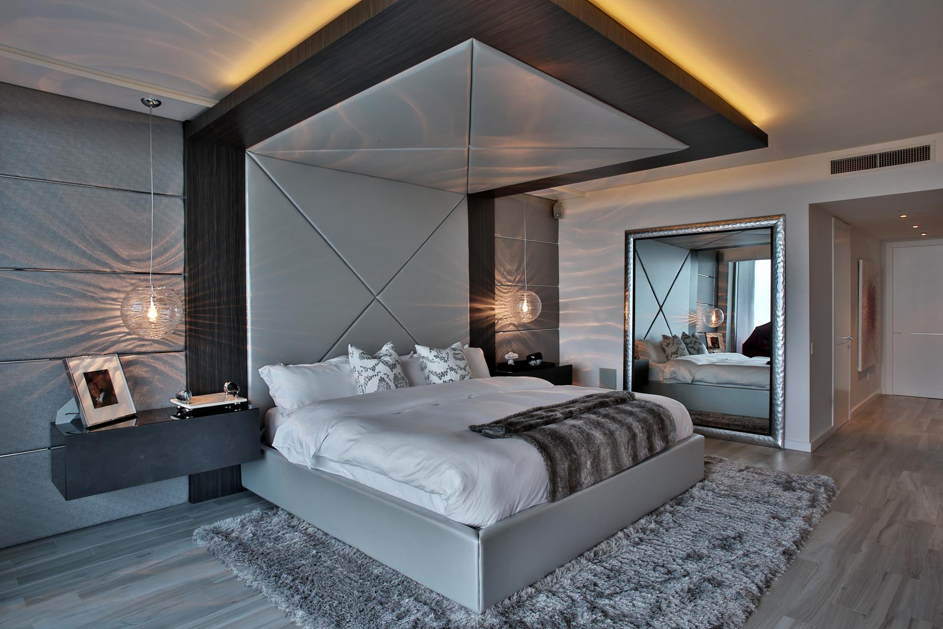 Douceur de chambre gris-violet confortable avec éclairage au néon