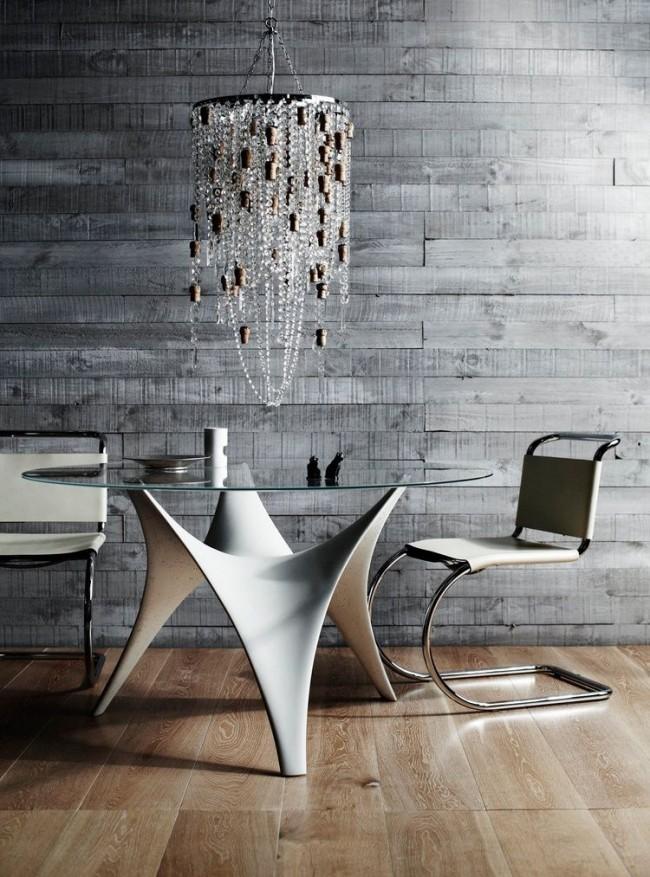 Tables à manger.  Table à manger en verre pour trois personnes avec base voûtée sculptée en béton