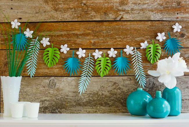 D'élégantes guirlandes de papier dans un style tropical