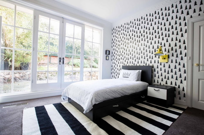 textiles à l'intérieur de la chambre en noir et blanc
