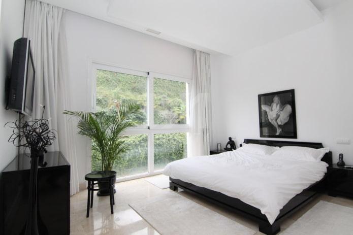 décoration et éclairage de la chambre en noir et blanc