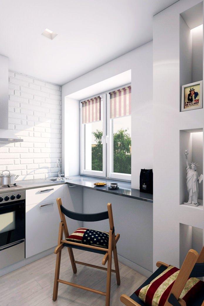 cuisine dans la conception d'un appartement de deux pièces dans une maison à panneaux