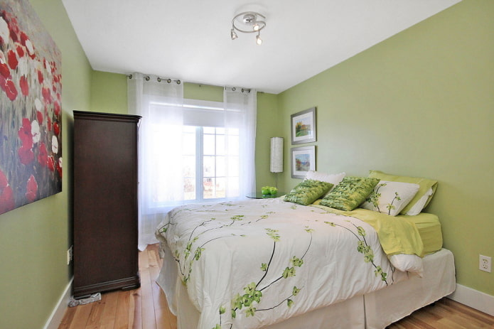 intérieur de la chambre aux tons pistache