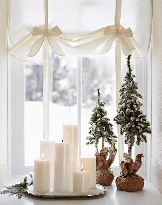 Bougies de différentes tailles, disposées sur un plateau - douces, pratiques et belles