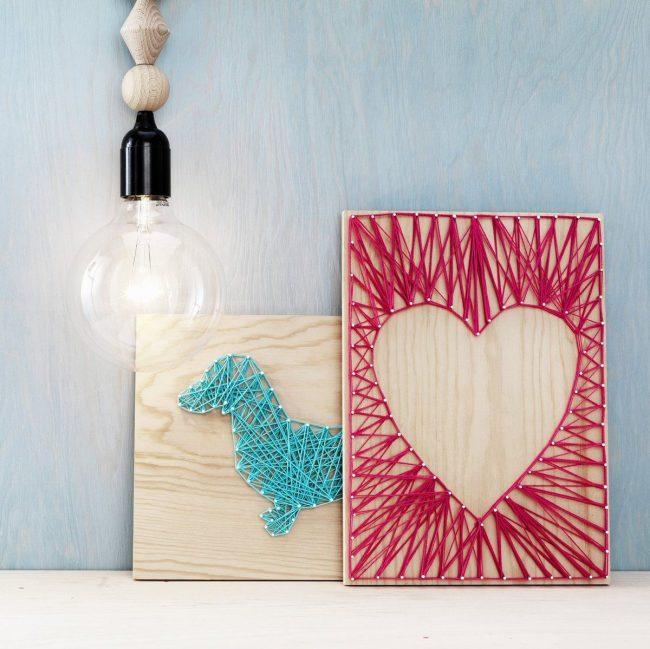 Un panneau de clous et de fils est un moyen facile de décorer une maison de vos propres mains