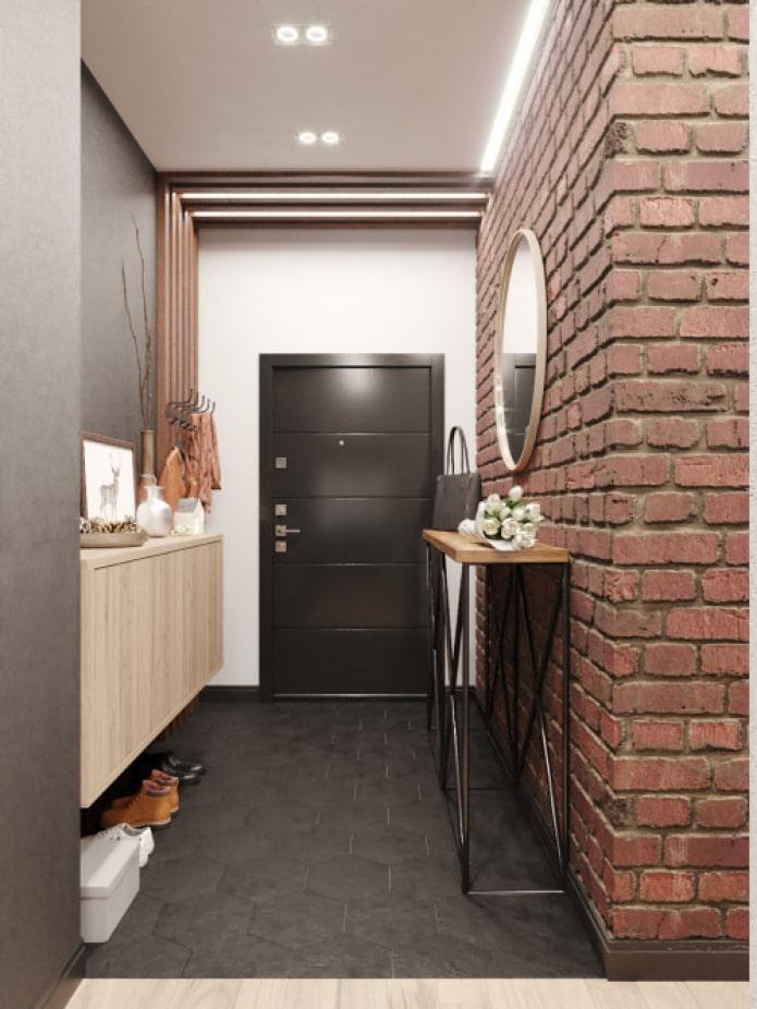 mur de briques dans le couloir