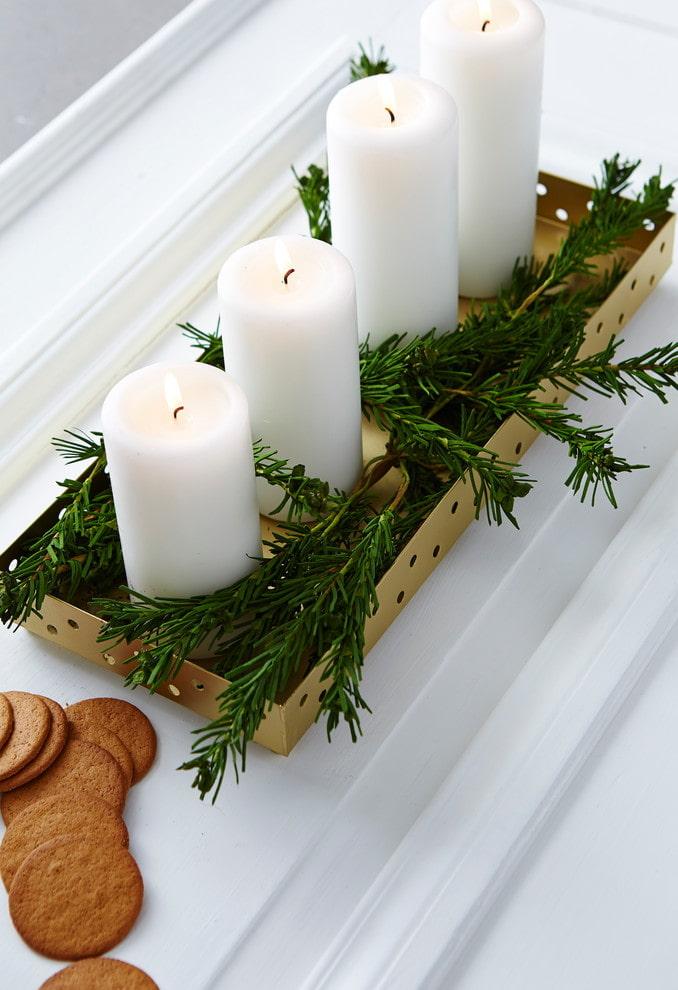 Bougies aux branches de sapin