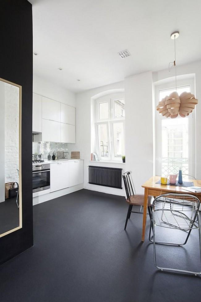 Sol gris mat comme solution inhabituelle pour la cuisine