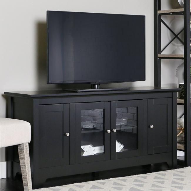 Meuble TV noir suffisamment grand et spacieux