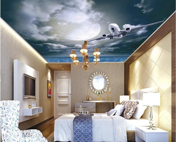 plafond avec une photo du ciel et un avion dans la chambre