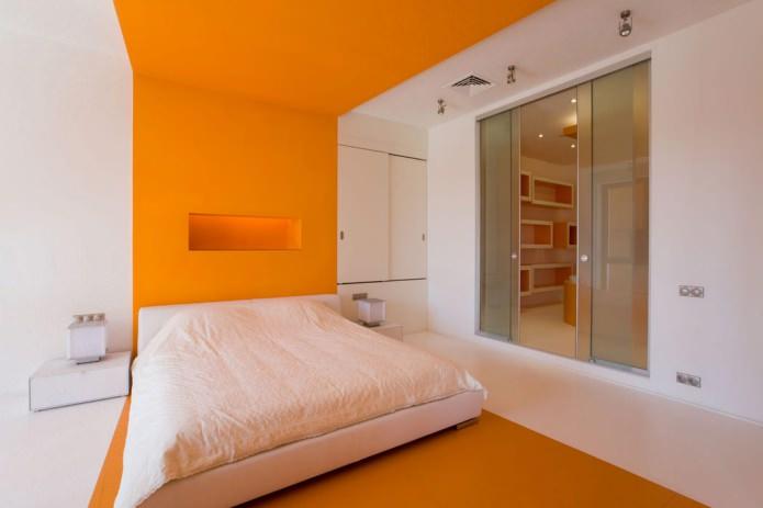 intérieur de la chambre orange et blanche