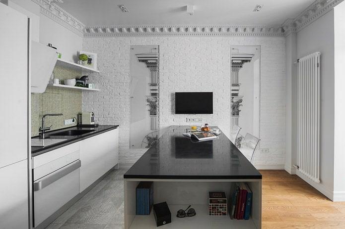 îlot de cuisine avec plan de travail noir brillant