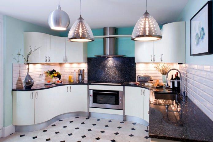 comptoir noir en pierre artificielle à l'intérieur de la cuisine