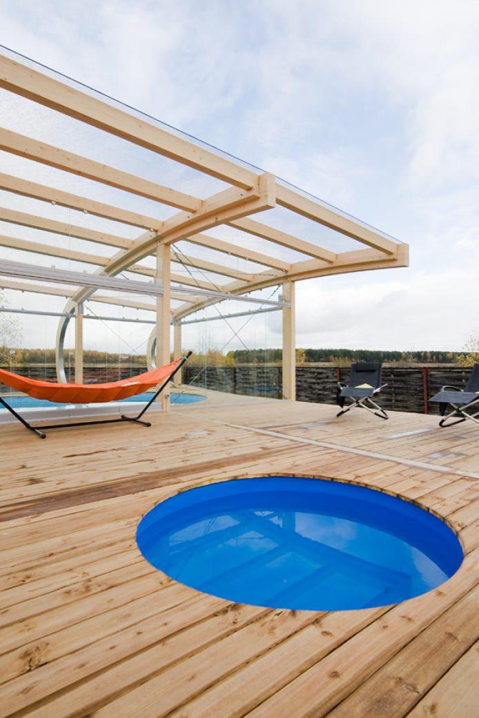 terrasse avec piscine et hamac