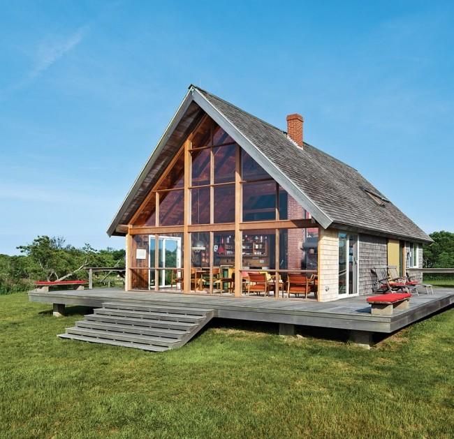 Maison à ossature cosy avec façade en verre