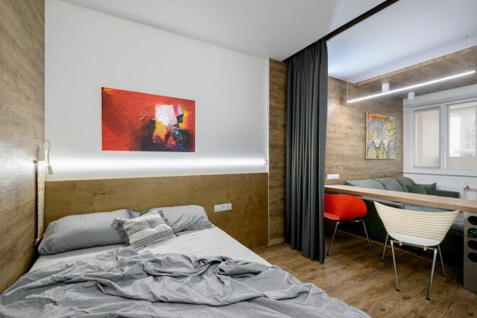 lit et canapé dans une chambre simple