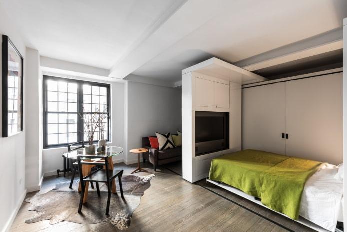 studio spacieux avec un lit