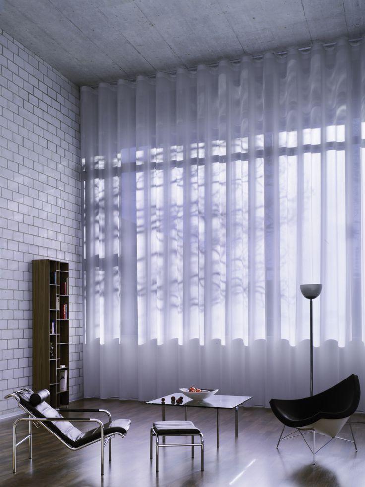 La texture mate du rideau créera une ambiance douce et pastel