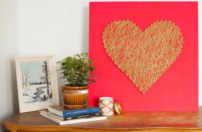 Coeur sur fond rose