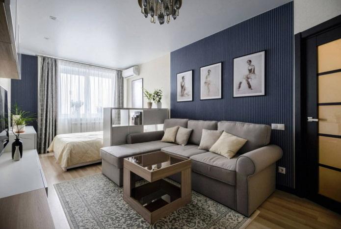 canapé avec lit dans une chambre