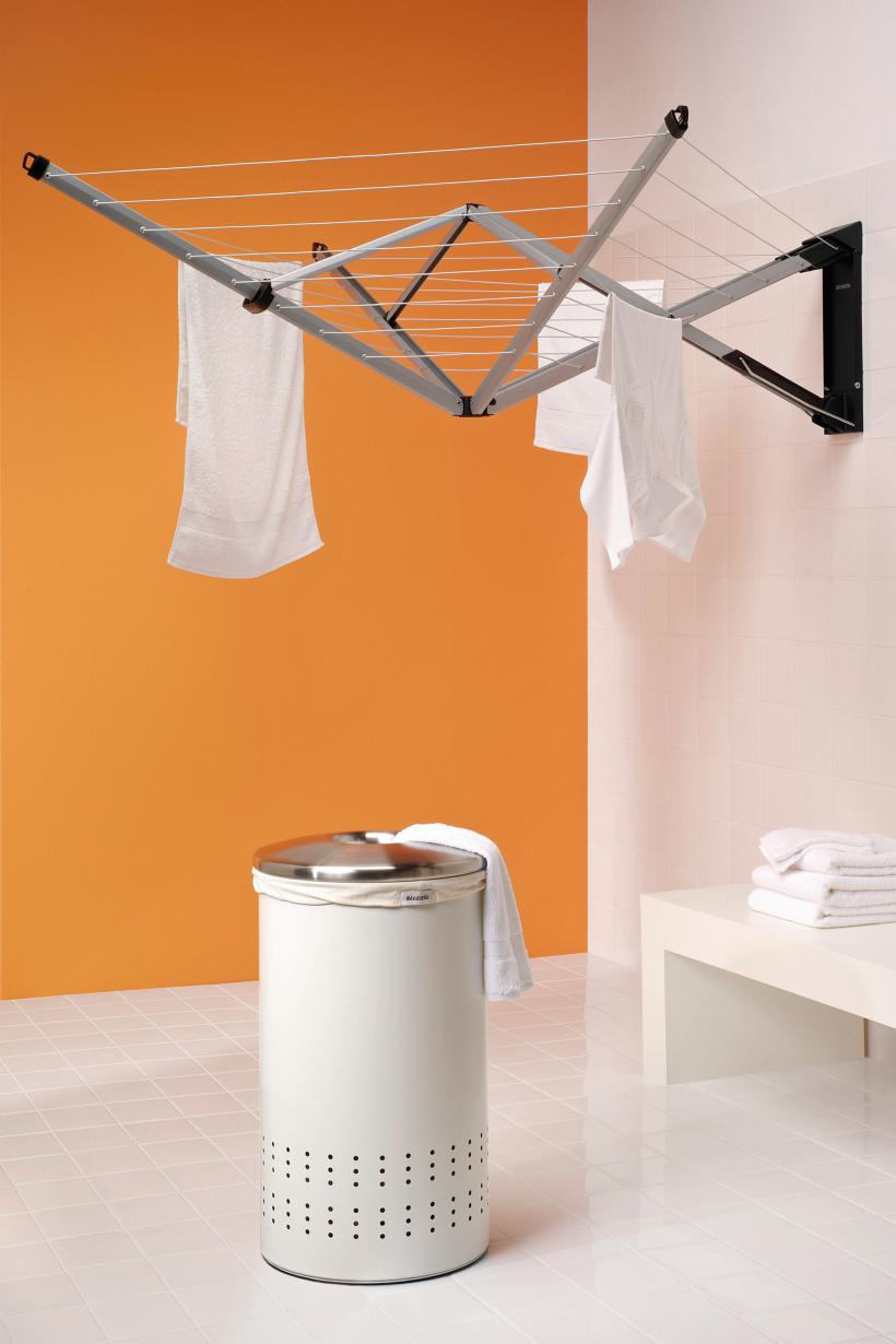 Sèche-linge moderne qui prend un minimum de place et se plie d'un seul mouvement de la main