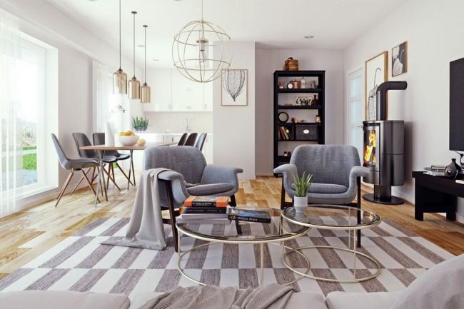 La palette globale de couleurs froides du salon a l'air confortable en raison de l'abondance d'éclairage, de textiles et d'éléments de décoration