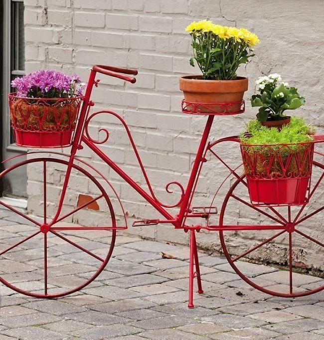 Support forgé pour fleurs stylisé comme un vélo