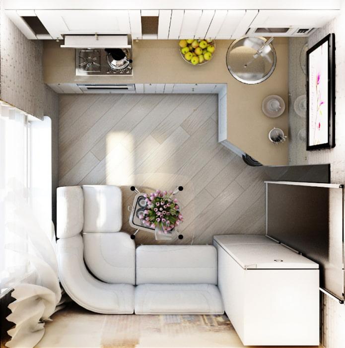 Aménagement de la cuisine-séjour avec un canapé d'angle