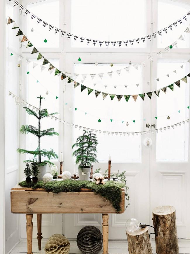 Les guirlandes peuvent être fabriquées à partir de n'importe quoi: une option élégante de feuilles de magazine pour décorer une fête